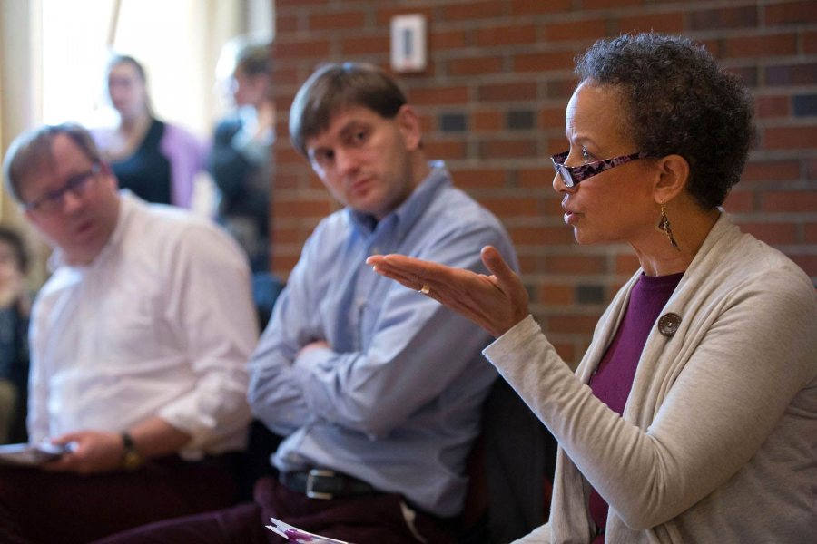"While fellow politics faculty John Baughman and Ben Moodie look on, Leslie Hill makes a point during the department's ""What Just Happened?"" election analysis on Nov. 9 in the Mays Center. (Phyllis Graber Jensen)"