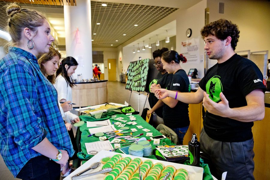Blake Reilly talks with students during a special Green Dot dinner held during program's launch in fall 2015.