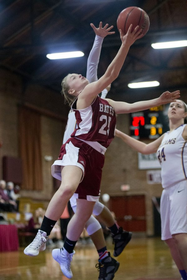 Women's basketball opens the new year for the Bobcats. Shown in a February 2016 game against Williams is co-captain Bernadette Connors '17. (Phyllis Graber Jensen/Bates College)
