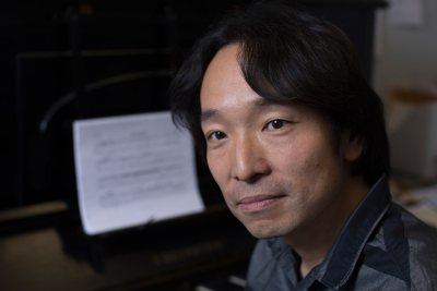 Hiroya Miura, associate professor of music st Bates, is shown in his Olin Arts Center office shortly before he attended a contemporary-music festival in Cuba. (Phyllis Graber Jensen/Bates College)