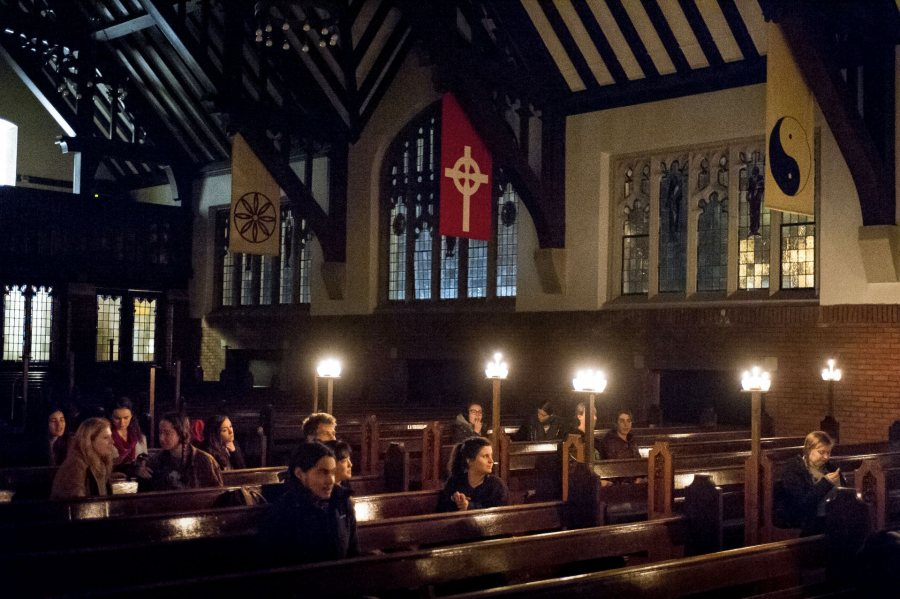 Students gather by candlelight in the Gomes Chapel on Nov. 30 2016 for Pause.