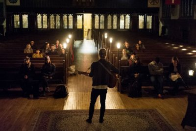 Jackson Whitehouse '17 of Cleveland plays the guitar during the Nov. 30 {Pause}, sponsored by the Multifaith Chaplaincy. (Josh Kuckens/Bates College)
