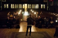Jackson Whitehouse '17 of Cleveland, Ohio, plays the guitar during Pause on Nov. 30.