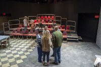 Actors in the production of The Pillowman gather  in their traditional circle before their dress rehearsal.