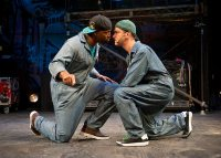 In Chicago Shakespeare Theater's production of Othello: The Remix, Postell Pringle '98 (left, as Othello) and GQ (Iago) face off as Iago's plot unfolds. (Photograph by Michael Brosilow)