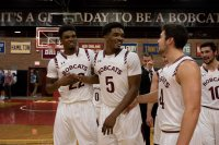 Marcus Delpeche scored a game-high 25 points, Malcolm Delpeche tallied a double-double and the Bates men's basketball team took an early lead and never looked back in their 74-60 victory over Bowdoin in a non-league game Wednesday night at Alumni Gym. Celebrating at game's end, from left,