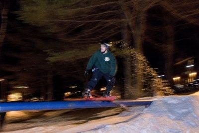 Thorn Merrill '19 of Morrisville, Vt., take to the rail jam behind Smith Hall.