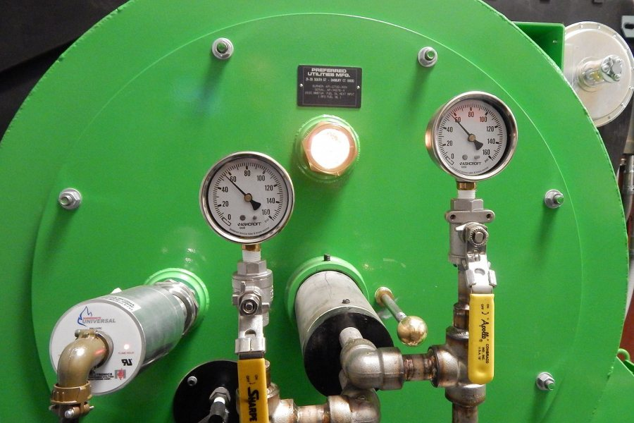 The new RFO burner on the central steam plant's boiler No. 1. Note the viewing port between the gauges. (Doug Hubley/Bates College)