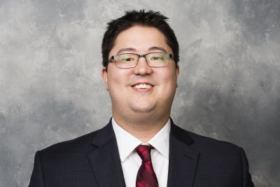 Tim Ohashi '11 is the hockey operations analyst for the Washington Capitals of the NHL. (Photo by Patrick McDermott/NHLI via Getty Images)