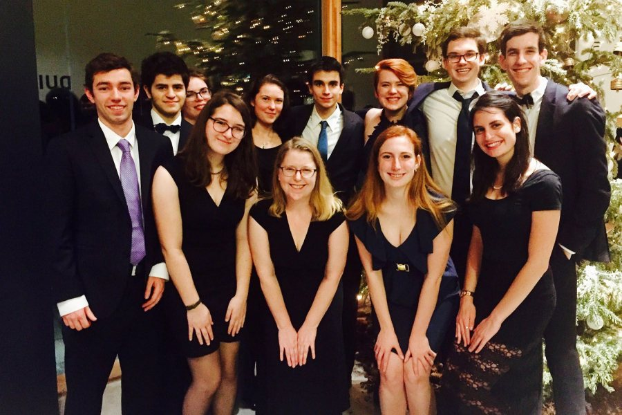 The Bates contingent poses for a photo during WUDC 2017, including Taylor Blackburn '15 (back row, third from right) whose team advanced to the octofinal round in 2015. (Tess Holtzman '18)