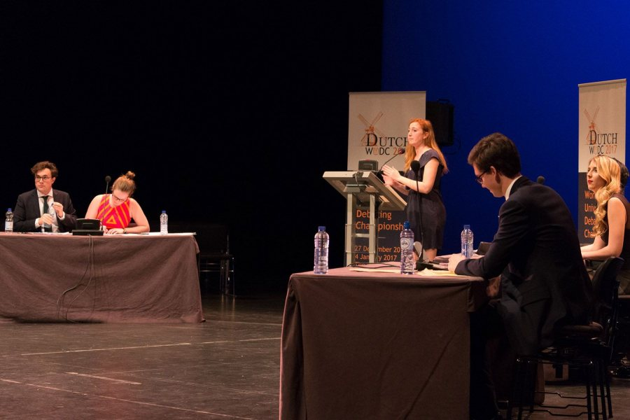 Zoë Seaman-Grant '17 is at the lectern, while teammate Matt Davis '18 takes notes, right, during the final round of the 2017 World Universities Debating Championships in The Hague, Netherlands. (Dutch WUDC 2017 / Manuel J. Adams)