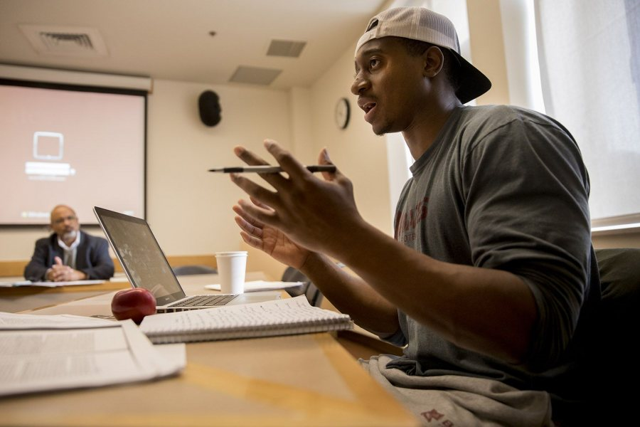 Ben Coulibay '17, a philosophy major from Philadelphia, joins the discussion on Dec. 8 during the Benjamin Mays course taught by Marcus Bruce '77, the Benjamin E. Mays Distinguished Professor of Religious Studies. (Phyllis Graber Jensen/Bates College)