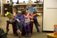 Children read books from the Picture Book Collection in Ladd Library during the college's 2017 Martin Luther King Jr. Day observance. (Phyllis Graber Jensen/Bates College)