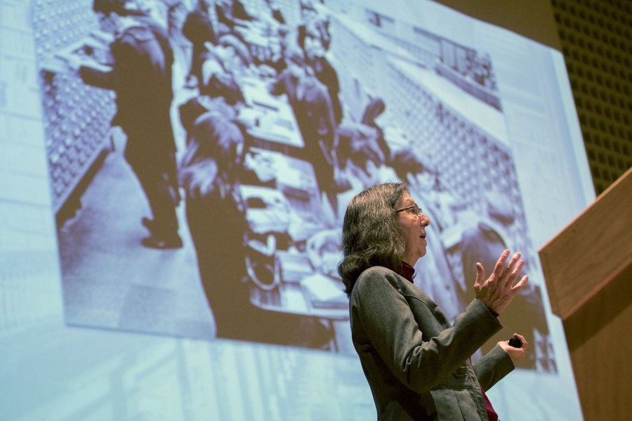 College Key Distinguished Alumna in Residence Susan Dumais '75 gives a talk on Feb. 1 in the Olin Arts Center Concert Hall in front of an image showing a bygone way to retrieve information: the card catalog. (Phyllis Graber Jensen/Bates College)
