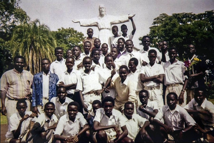 Patrick Otim, 14, third row, third from left, posing with his classmates at the Sacred Heart Seminary in Gulu, Uganda.