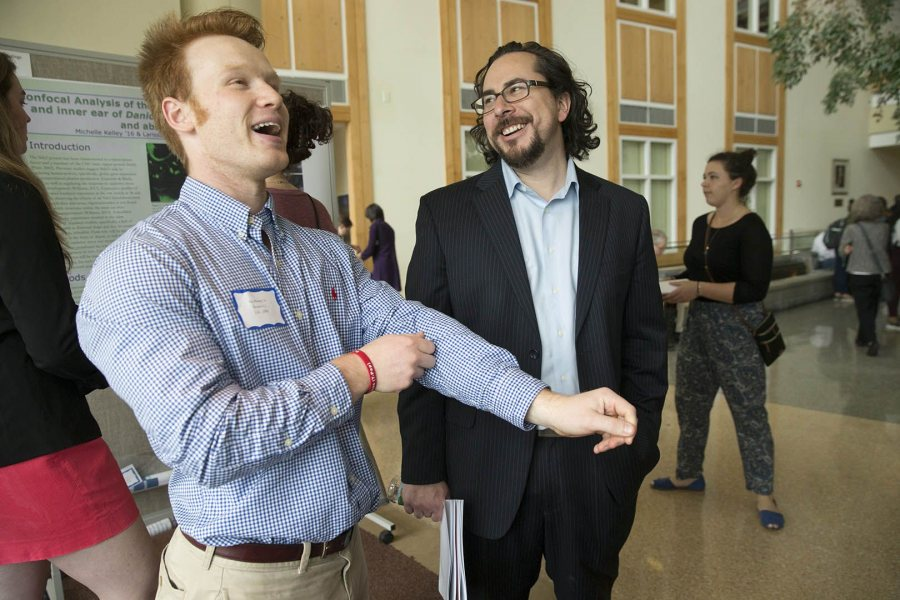 Ian Ramsey '16, a mathematics and biochemistry double major, laughs with Assistant Professor of Neurocience Jason Castro at the 2016 Mount David Summit. (Phyllis Graber Jensen/Bates)