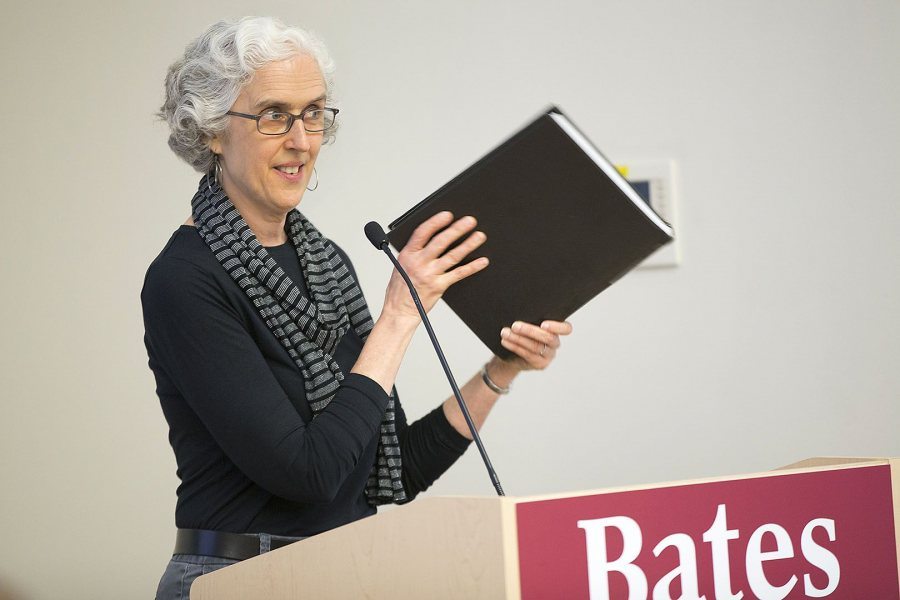 At the 2016 banquet for seniors who earned honors in their majors, Professor of Sociology Emily Kane introduces the guest speaker, Bridget Harr '07, Kane's former student and current colleague in the sociology department. (Phyllis Graber Jensen/Bates College)