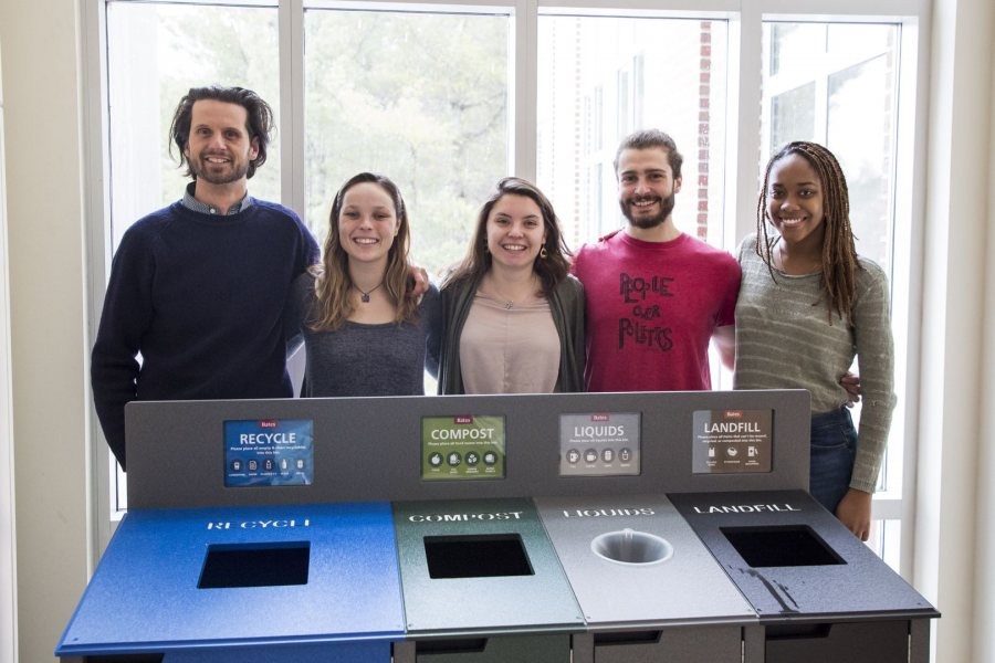 Bates EcoReps Isa Moise '19, Beanie O'Shea '18, Hannah Slattery '18, and George Fiske '19 show off the college's new color-coded waste receptacles. (Josh Kuckens/Bates College)