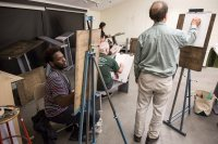 Deshun Peoples '17 (left) of Chicago is among the artists who joined the figure drawing session on March 8. (Josh Kuckens/Bates College)