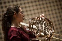 Leah Sturman '17 of Huntington Beach, Calif., plays her french horn part.  The Bates Brass Ensemble, led by Olin Arts manager Alan Carr, rehearses Wednesday night, Mar. 22 2017 in the Olin Arts Center.