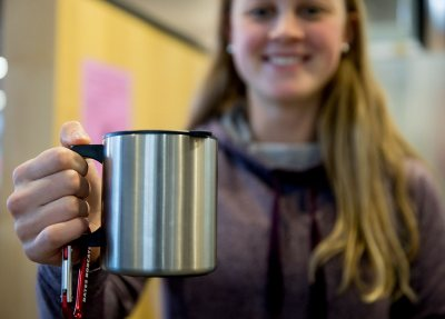 Mugging for the camera: Like every other Bates student on campus during Short Term, Laura Rand '18 of Barrington, R.I., will soon have a Personal Reusable Container like this to call her own. (Phyllis Graber Jensen/Bates College)