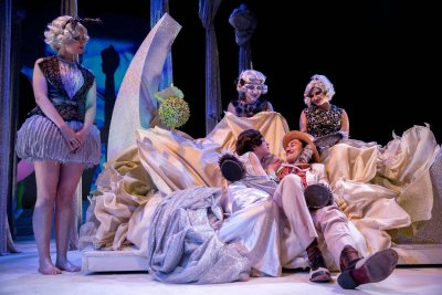 Under a spell, Titania (Tricia Crimmins '19) lounges in bed with Bottom (Dan Kuan Peeples '17), who's been made to look like a donkey by Puck. They're attended by fairies Moth (Anna Kreitzer '19), Mustardseed (Anne Trapp '20) and Peaseblossom (Rebecca Kraft '20). (Phyllis Graber Jensen/Bates College)