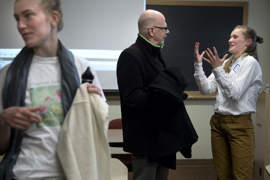 Woods Fairchild '18 of Boston, Mass., talks with Associate Professor of Russian Dennis Browne after her panel presentation. (Phyllis Graber Jensen/Bates College)