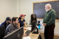 Economics professor Michael Murray works with students in his econometrics course on April 3 during the final week of classes. (Phyllis Graber Jensen/Bates College)