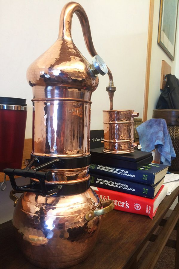 "Economics professor Jim Hughes will use this copper still to make rum in the course ""Six Beverages That Changed the World."" (Jay Burns/Bates College)"