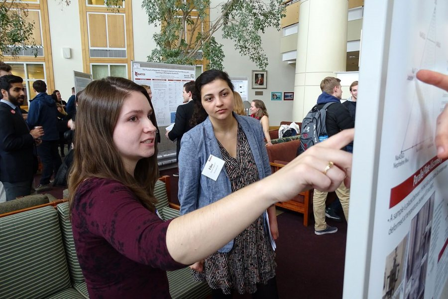 Gwenyth Williams '17 talks with classmate Elise Emile '17 about her geology poster. (Jay Burns/Bates College)