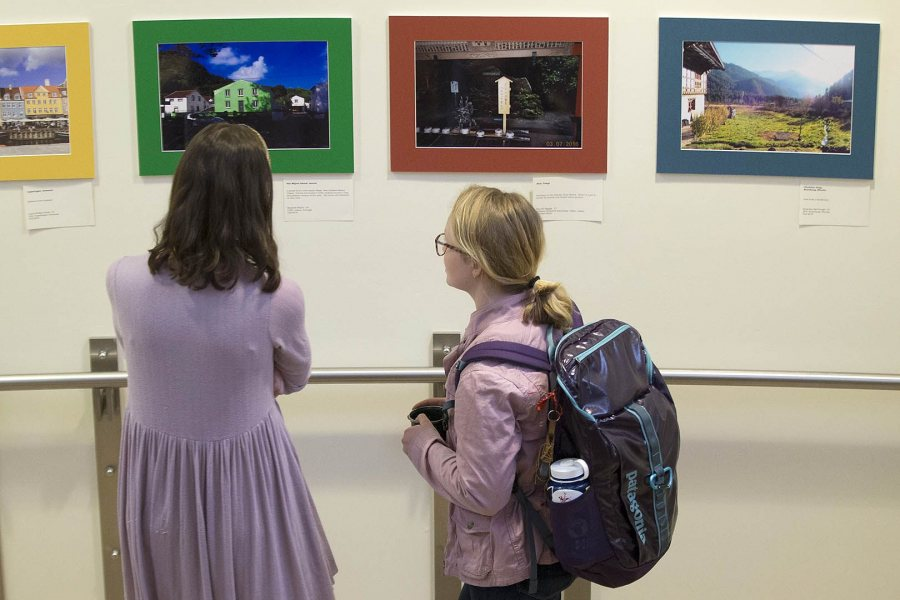Students view images in the Barlow Off-Campus Photography Exhibition during Mount David Summit on March 31. (Phyllis Graber Jensen/Bates College)