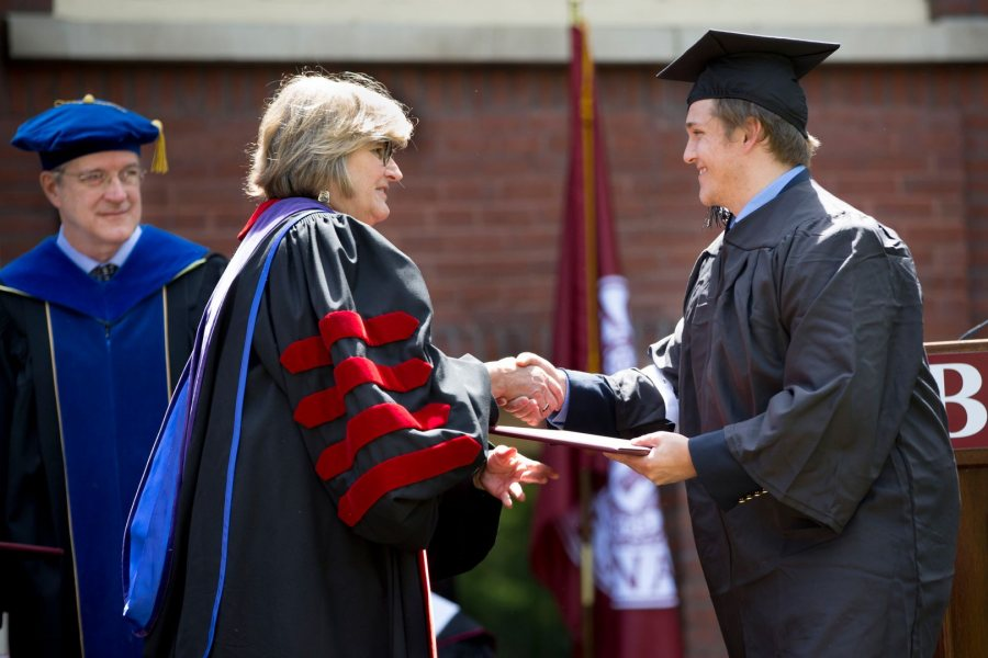President Clayton Spencer awards Cormac Walsh '17 of Biddeford, Maine, a bachelor of science degree in biological chemistry. (Phyllis Graber Jensen/Bates College)