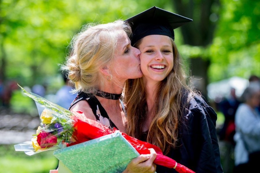 Jessica Wilson of Cumberland, Maine, receives a kiss from her proud mother, Julie Hanlon, after receiving a degree in environmental studies. (Phyllis Graber Jensen/Bates College)