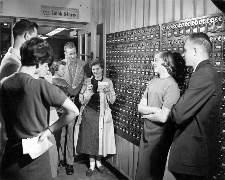 """Students get their mail in Chase Hall this 1950s photograph. Then and now, """"the warmth of [Bates] has endured since Dad was here,"""" says Mike Bonney. (Muskie Archives and Special Collections Library)"""