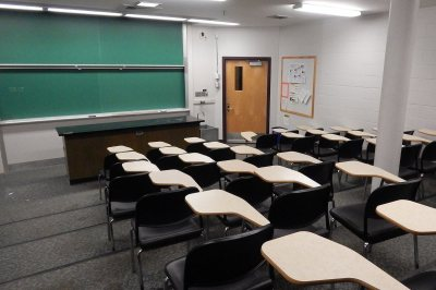 """In support of """"active learning,"""" Carnegie 339 will lose its tiered seating and lab bench -- and with them its frontward focus -- but will gain whiteboards all around and tables that enable a variety of furniture placement. (Doug Hubley/Bates College)"""