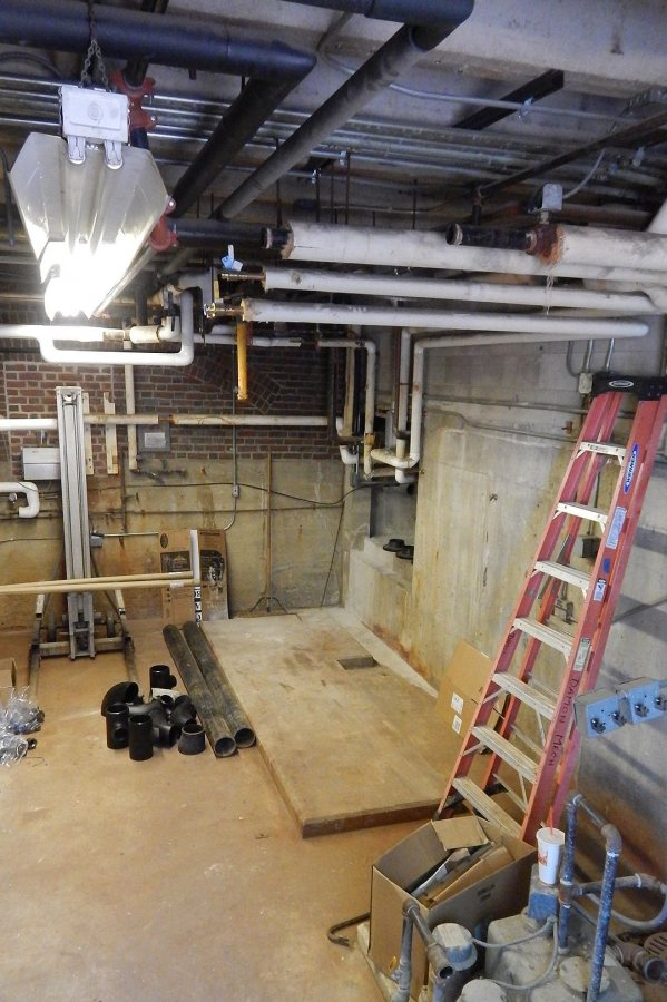Shown on June 14, 2017, the Chase Hall mechanical room awaits a major installation of steam heat-exchange and hydronic equipment. (Doug Hubley/Bates College)