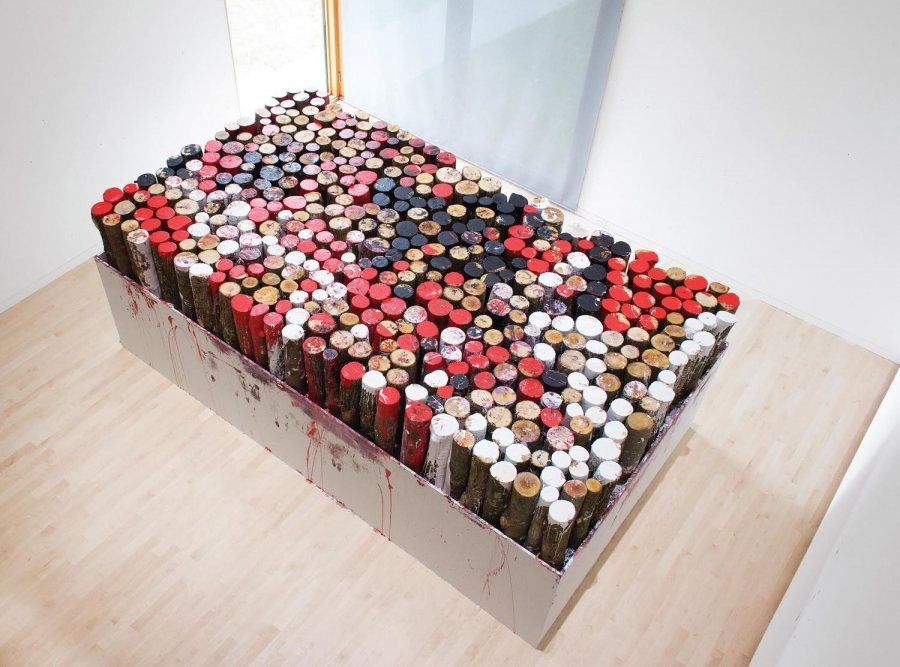 "For ""Roll in the Way,"" a work responding to the machismo of artists like Richard Serra, Kate Gilmore dipped more than 500 pieces of wood in paint and placed them on this platform."