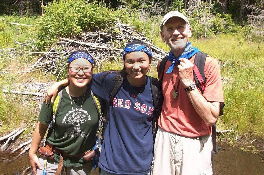 John Creasy poses with geology majors Saebyul Choe '14 and Sula Watermulder '14 during a mapping project in the Gilead Quad in western Maine. The two majors had given Creasy the matching blue bandana for the trip. (Photograph by Dykstra Eusden '80)