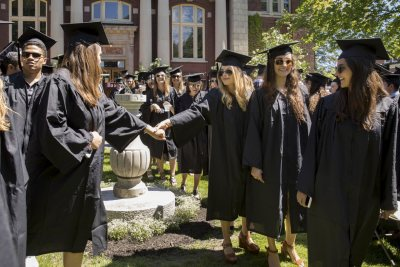 Seniors reach out to one another during Baccalaureate on May 27. (Phyllis Graber Jensen/Bates College)