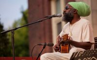 Shown in a 2013 Concert on the Quad at Bates, Corey Harris '91 brings his distinctive brand of roots music back to Bates on Sept. 24. (Phyllis Graber Jensen/Bates College)