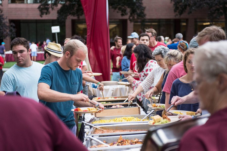 Shown in 2016, the Opening Day barbecue for new students and families is an annual tradition. The menu for 2017 includes pulled pork and chicken, chipotle tofu, and, this being Maine, three varieties of whoopie pies. (Josh Kuckens/Bates College)