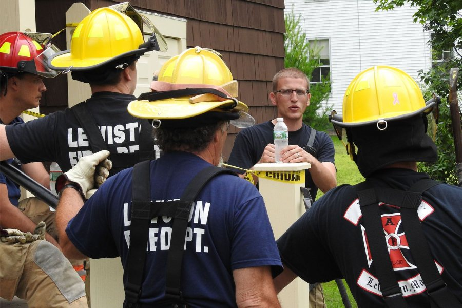 Lewiston firefighter Eric Watson, the training leader, talks to his firefighters on July 18, the first of three days of training at Holmes House. (Jay Burns/Bates College)