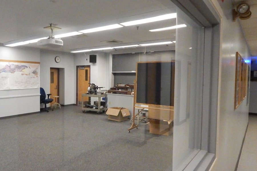 "Awaiting ""node chairs"" and whiteboards is Carnegie 225, one of two refitted active-learning classrooms in the science building. The room is seen from a corridor through a new window intended to impart a sense of spaciousness. (Doug Hubley/Bates College)"