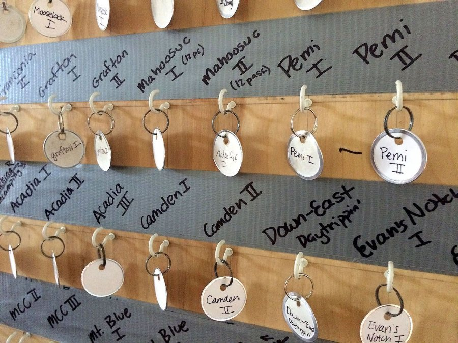Empty keytags hang on a board in Memorial Commons below the names of various destinations for first-year AESOP trips during Orientation. The keytags will soon be filled with vehicle keys for 60 vans and trucks that will take first-years on their outdoor and service trips throughout Maine and New Hampshire. (Jay Burns/Bates College)