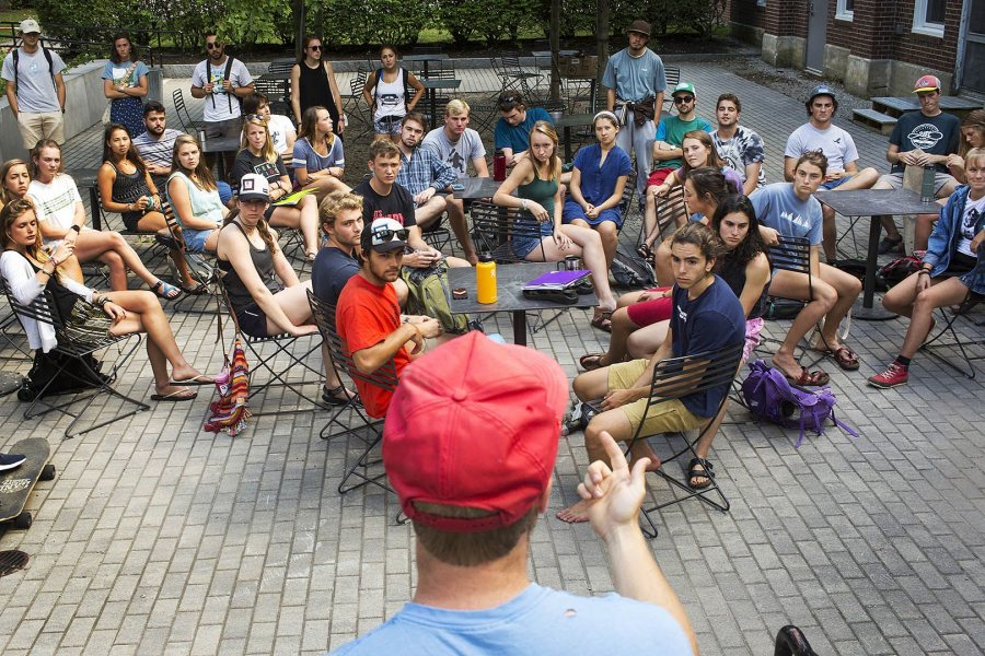 AESOP co-coordinator Kurt Niiler '18 of Freedom, N.H., demonstrates to AESOP trip leaders how to tie a bowline knot and a trucker's hitch knot during training outside of Chase Hall on Aug. 24. (Theophil Syslo/Bates College)