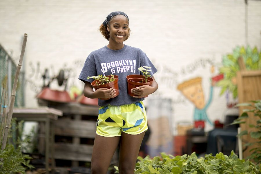 """These internships have really opened my eyes. Farming can happen in New York. We actually have 250 days of a farming season here. I want to go into food and agriculture to help out with people who don't have access to fresh foods and medicinal herbs so they can take care of what they put into their bodies."".-- Environmental Studies major Isa Moise '19 of Mount Vernon, N.Y., poses at Oko Farms in Brooklyn, N.Y., where she works with an organization that utilizes a hybrid of aquaculture and hydroponics known as aquaponics to raise freshwater fish along with a variety of vegetables and fruits. ""This has really humbled me,"" she says of her experience of learning to grow and nurture plants and raise fish. ""You really can't control everything."" That's part of the learning process, she says of ""how to grow sustainable food that's good for the environment."".Moise also has an internship this summer at the Farm School NYC, an organization that trains local residents in urban agriculture to build self-reliant communities and inspire positive local action around food access and social, economic, and racial justice issues..Moise's two internships are funded by the Bates Purposeful Work Internship Program."