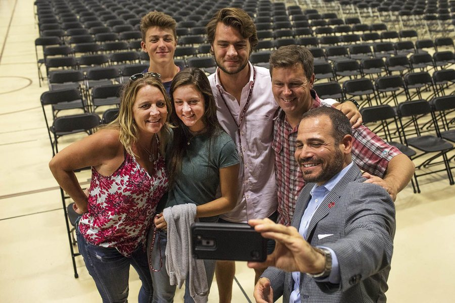 Director of Athletics Jason Fein snaps a selfie with the Cote family after his Opening Day welcoming remarks to student athletes and their families at the Clifton Daggett Gray Athletic Building on Aug. 28. Jackson Cote '21 (center) of Wilton, Conn., is an aspiring rower. (Theophil Syslo/Bates College)