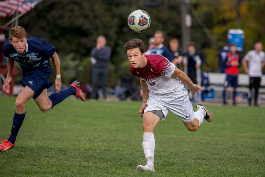 Shown heading the ball to a teammate against Connecticut College a year ago, Nate Merchant '18 has been men's soccer's leading scorer each of the past two seasons. (Phyllis Graber Jensen/Bates College)