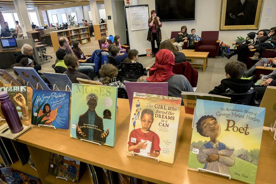 Author and illustrator Anne Sibley O'Brien reads from books in the Picture Book Collection in Ladd Library during the college's 2017 Martin Luther King Jr. Day observance. (Phyllis Graber Jensen/Bates College)