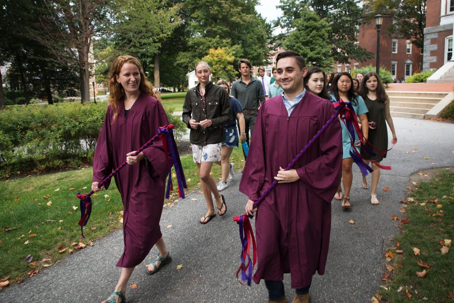 Isabella Miller ' 18 of New York, N.Y., and John Dello Russo '18 of Revere, Mass., senior marshals, reacts while leading their classmates at the start the Processional during the Opening Convocation on Tuesday. (Theophil Syslo/Bates College)